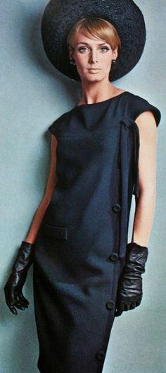 Deborah Dixon is wearing a one piece dress by Pierre Cardin, 1965