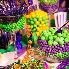 Candy as colorful as Carnival! Set up a candy buffet of green, purple and yellow.  Fill up clear containers with gumballs, Sixlets®, candy sticks and more for all your party revelers!