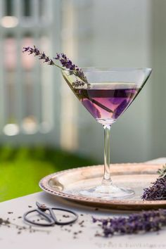 LAVENDER MARTINI ~ Ingredients:  1 oz Crème de Violette,     1 oz Gin (we used Bluecoat),     1 oz Vodka (we used Belvedere),     ¼ oz Domaine de Canton,     ¼ oz St. Germaine (elderflower liqueur),     1 dash Scrappy's Lavender Bitters,     Fresh cut lavender for garnish.  Instructions: Add all ingredients into a cocktail shaker with ice. Shake well for 30 seconds and pour into a martini glass. Garnish with fresh lavender springs.