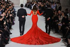 Stephane Rolland Haute Couture SS 2012. This silhouette is out of this world. Alongside the vibrant red and flared train, the dress screams phoenix.