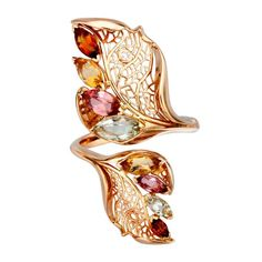 How beautiful is this organic jewellery shape? Carrera y Carrera has set marquise-cut smokey quartz, prasiolite and pink tourmalines in a rose gold ring ($2,950). Discover the history behind the romantic French gemstone-cut: http://www.thejewelleryeditor.com/jewellery/marquise-cut-gemstones-create-contrast/ #jewelry #style
