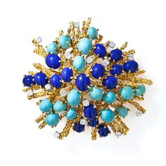 From the colorful 1960s comes this sizable and captivating free form work of modern jewelry art. Lapis, Turquoise, and Diamond Brooch