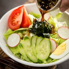 Simple and delicious soy sauce based Japanese salad dressing, flavored with grated onion, soy sauce, rice vinegar, and roasted sesame seeds.
