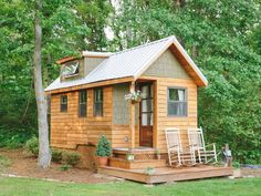 """The """"Wind River Bungalow"""" is the Chattanooga, Tennessee, home of tiny house enthusiasts Travis and Brittany Pyke, who started Wind River Custom Homes to help others fulfill their dreams of living simply in mini dream homes. from Country Living Tiny House Movement, Bungalow, A Frame Cabin, A Frame House, Cabins And Cottages, Tiny Cabins, Earthship, Tiny House Living, Tiny House Plans"""