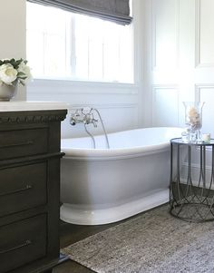Bathroom free standing bath and wall paneling. Bathtub: Metro Collection – Georgetown. Wall paneling behind free standing bath #freestandingbath #wallpaneling #bathroom Beautiful Homes of Instagram @SanctuaryHomeDecor