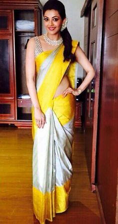 Kajal Agarwal in saree not only looks mesmerizing while wearing sarees but also keeps her look different than usual. Here are the best kajal saree collection. Half Saree Designs, Silk Saree Blouse Designs, Silk Sarees, Handloom Saree, Lehenga Choli, Set Saree, Saree Dress, Saree Wearing Styles, Saree Styles