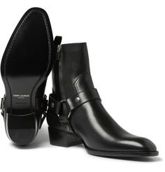 <a href='http://www.mrporter.com/mens/designers/saint_laurent'>Saint Laurent</a>'s brilliant leather boots feature harness straps over the bridges and ankles and a slight heel, creating a powerful, rakish look. The smooth black leather is ideal for teaming with a pair of the label's slick monochrome jeans, while the luxurious Italian construction is sure to put some attitude in your step.