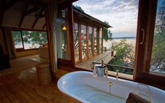 Explore Victoria Falls & Livingstone while you stay at the Tongabezi Lodge. The Tongabezi Lodge offers authentic accommodation, great food & much more. River Cottage, Most Romantic Places, Secluded Beach, Victoria Falls, Lodges, Wonders Of The World, Luxury, Zimbabwe