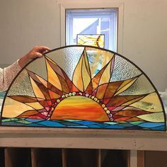 Consider SwellColors for your custom artwork. This sun stained glass was installed in a recently renovated dental office.