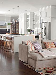 Wow..love this kitchen and family room setup! Gorgeous.