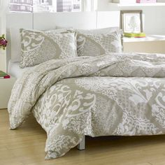 Refresh your master suite or guest room with this lovely cotton duvet cover set, showcasing an eye-catching damask motif in beige.    P...