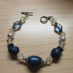You will love this Blue Lampwork Bracelet.  $14.00  You can find more at Artfire.com/deescreations2