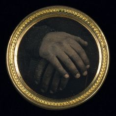 Daguerreotype button with an abolitionist motif. May be one of the first political buttons made in America to incorporate a photograph.
