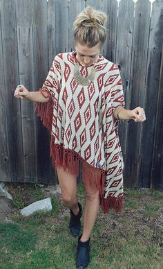 Fringed poncho worn over cut offs & paired with ankle boots. Ponchos are awesome transitional pieces for when nights become cooler.