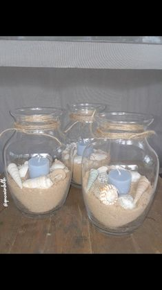Made my own centerpieces for my beach themed Quinceanera ! Found the shells, candles, and vases all at the dollar tree ! Made my own centerpieces for my beach themed Quinceanera ! Found the shells, candles, and vases all at the dollar tree ! Beach Themed Crafts, Beach Crafts, Shell Candles, Diy Candles, Quinceanera, Beach Centerpieces, Beach Centerpiece Wedding, Wedding Decorations, Beach Wedding Favors