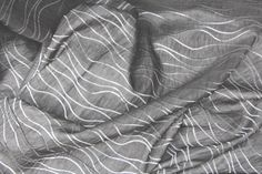 """Description Pewter """"shantung"""" fabric embroidered with metallic platinum wavy lines. Sewn with a french seam for reversible application;"""
