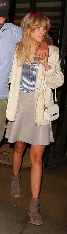 Suki Waterhouse, blue stripe button down shirt and brown leather skirt