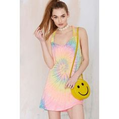 Unif Rae Tie-Dye Dress Peace, love, and psychedelic summer duds. The Rae Dress is made in an ultra soft modal/cotton blend and features neon tie-dye print, pockets, racer back, and scrunchie-inspired gathering detail at straps. Killer with high-top sneakers for a sportier look, or leather sandals and a backpack for your beach daze. By UNIF. UNIF Dresses