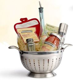 Do it Yourself Gift Basket Ideas for Any and All Occasions Pretty Food Gift Basket DIY - Use a Colander for a Foodie Gift via World Market - Do it Yourself Gift Baskets Ideas for All Occasions - Perfect for Christmas - Birthday or anytime! Food Gift Baskets, Themed Gift Baskets, Raffle Baskets, Basket Gift, Gift Basket Themes, Creative Gift Baskets, Theme Baskets, Kitchen Gift Baskets, Family Gift Baskets