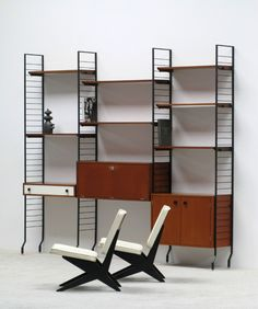Combineurop modern teak Wall unit | 20th century Modern online gallery. Featuring a large and varied selection of quality vintage pieces | Shipping worldwide | http://www.furniture-love.com/furniture/