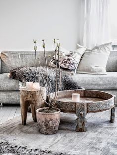 Distressed chic - I want the round coffee table.