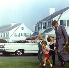 Caroline Kennedy whispers to her father during August 26, 1963 visit to Hyannis Port, Massachusetts. (Cecil Stoughton/JFK Library)
