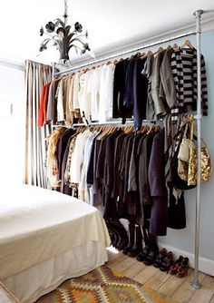 "make ""closet"" space: i have done this for a a few years, except mine was on mobile racks..i love this pipe fitting permanent idea..."