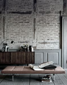 Exposed brick wall & daybed by Poul Kjærholm