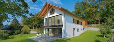 Moderne Holzhäuser von Gruber gibt es in allen Formen und Fassaden - selbsverständlich auch mit Putz.