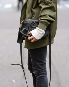 green jacket, Gucci bag, blue sunglasses & faded black jeans #style #fashion