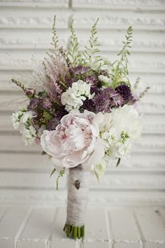 A rustic chic wedding bouquet. Subtle coloring and greenery.