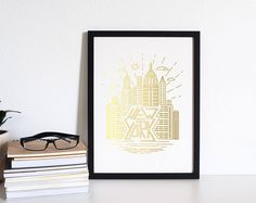 Unique New York City gold foil illustration. Would make really cool shelf art or wall art.