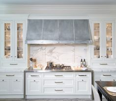Monday Musing: Honed Marble - O'Brien Harris Group - love the stainless steel range hood and gorgeous glass front cabinets
