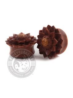 """Description What is it? Great for your ears and easy on the nose, wood plugs are always a great idea. Try not to wear these carved flower wood plugs in water, and make sure you keep them away from fire. Product Details What is it made of? Material: Saba Wood Plug Size: 0g-1"""" Wearable Area: 10.8mm *Please note that these measurements are based on averages* Class: Wood Color: Medium Reddish Brown Wood Plugs, Wood Colors, Place Card Holders, Carving, Clay, Flowers, Reddish Brown, Ears, Note"""