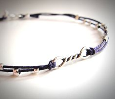 a tiny sterling silver twist bracelet on purple linen...or you choose the color! $22 from JewelryByMaeBee on Etsy.