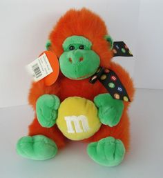 "M&M's World Plush Gorilla 9"" New w Tags Orange Holding Yellow Candy Ribbon Mars"