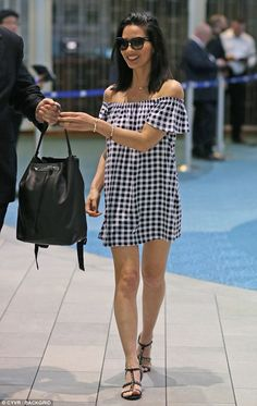 Hold this please: Olivia Munn, 36, was seen with a $4,000 The Row black backpack on Sunday...