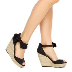 Platform wedge with a bow-embellished ankle strap.