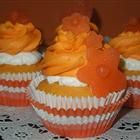 Dreamy Orange Cupcakes-flowers are cute :)
