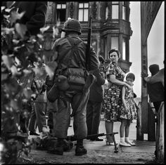 American soldiers, Friedrichstrasse near Checkpoint Charlie, at the time of the construction of the Berlin Wall, West Berlin, Germany, August 1961. Photo by Don McCullin