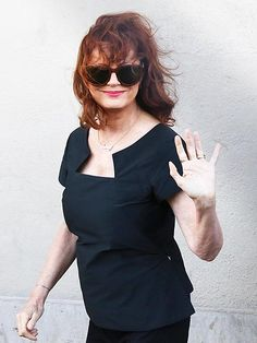 Star Tracks: Friday, July 4, 2014 | IT'S SHOW TIME | Susan Sarandon gives a friendly wave to fans outside the Jimmy Kimmel Live studio Wednesday in Hollywood, where she and the late-night host jokingly re-created the famous selfie the actress took in 1991 with her Thelma & Louise costar Geena Davis.