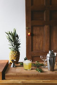 Pineapple Ginger Cocktail    makes one drink    1 1/2oz spiced rum  1 1/2oz pineapple juice  3/4 oz ginger syrup    Mix and pour over ice.