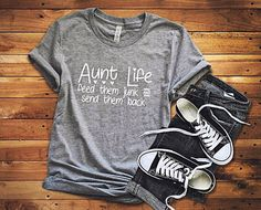 Beautiful made to order T- Shirts and Sweatshirts. Heather Grey Aunt Life T-shirt. Accessories not included. Details: -4.2 oz -Soft poly/Cotton blend -Side seams, retail fit -Shoulder to shoulder taping -Unisex sizing -Very Soft -Ladies, for a fitted look size down. But please refer