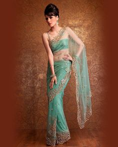 Pistachio green net saree covered with floral bootis in stone work and edged with a richly embellished gold cut work border, very understated and very sexy. Indian Attire, Indian Wear, Indian Outfits, Indian Dresses, Indiana, Desi Clothes, Ethnic Clothes, Indian Clothes, Indian Look