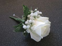 Ivory rose buttonhole with gypsophila and ivy base