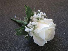 Ivory rose buttonhole with gypsophila and ivy base