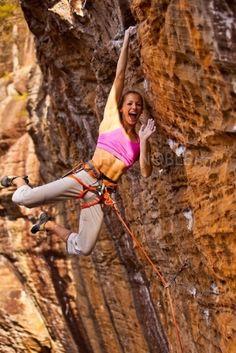 She seems to be having way too much fun:-) ... rock climbing