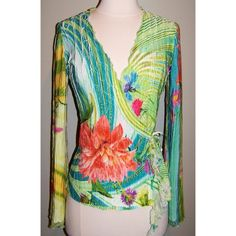 """Cache Ruffle Floral Wrap Blouse Top Size Small brand: Caché style: wrap blouse top womens tag size: small color: multi color 100% polyester  condition: -exellent overall pre-owned condition -see pics for details  approximate measurements flat across unstretched: chest - underarm to underarm: 16"""" length - top of back to bottom hem: 24"""" shoulders - seam to seam across the back: 12.5"""" sleeve length - shoulder seam to cuff: 24""""  t792-155 Cache Tops Blouses"""