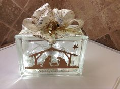 """SPECIAL ORDER """"NATIVITY - MERRY CHRISTMAS"""" LASER ETCHED IN GOLD WITH GOLD RIBBON EMBELLISHMENT AND WARM LED BATTERY OPERATED LIGHTS. Laser etching by Lavene & Co."""