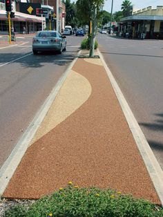 Two colours used to create an elegant pattern in this permeable median strip in Perth.